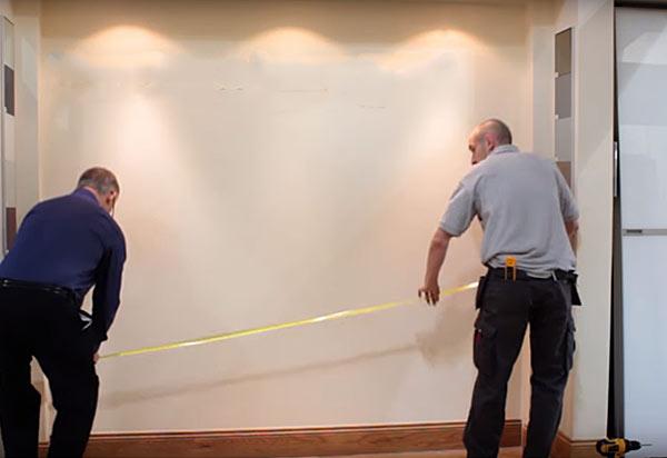 измерение ширины стены